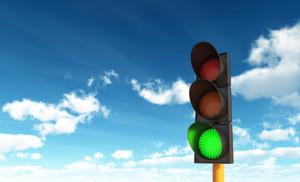 green traffic light sky